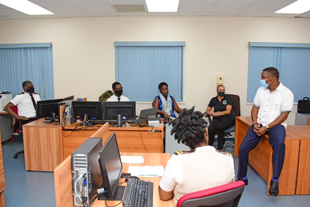 Minister Meets Officers In Immigration's Special Unit