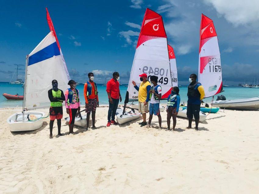 Minister Presents O'pen Skiff Sailboats To BSA